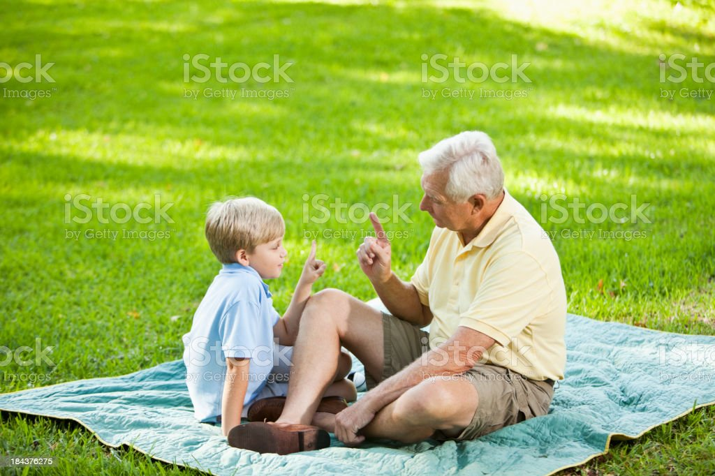 Grandfather and grandson outdoors stock photo