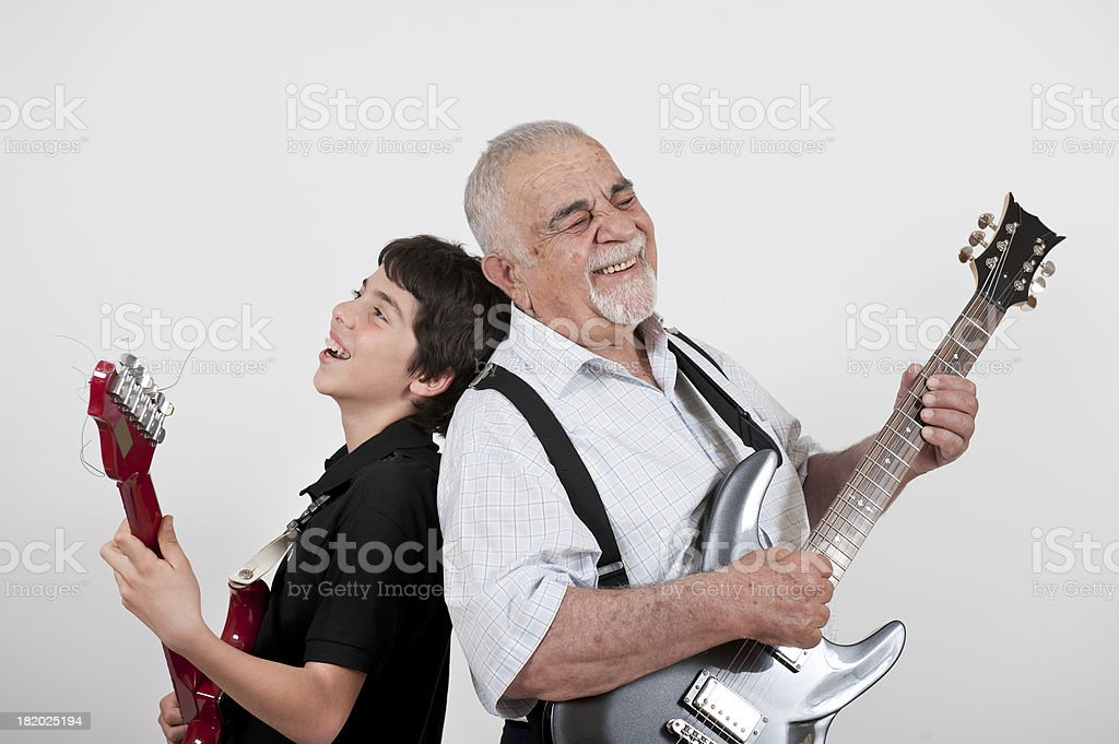 Grandfather and Grandson playing guitars royalty-free stock photo