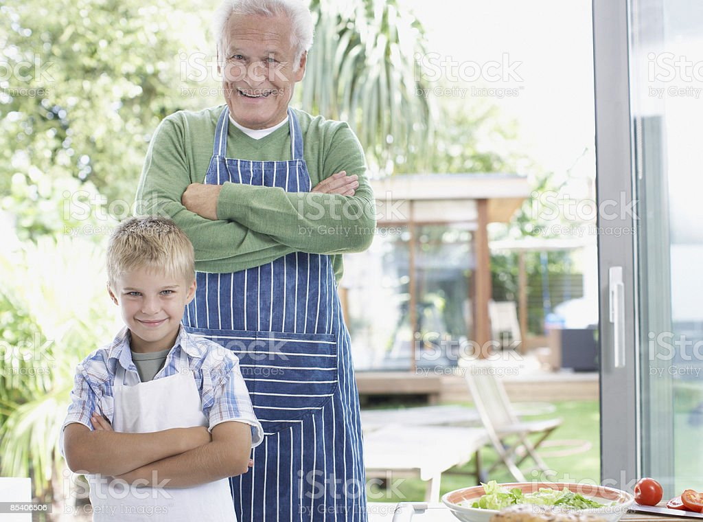 Grandfather and grandson preparing healthy meal royalty-free stock photo