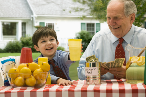 Grandfather and grandson selling lemonade