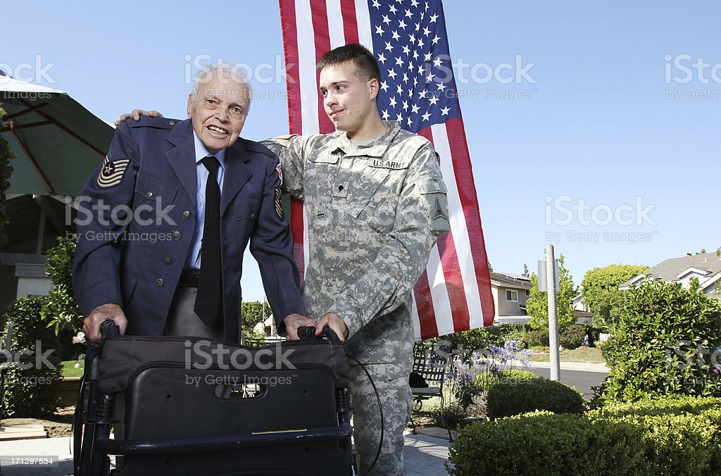 Grandfather and grandson soldiers stock photo