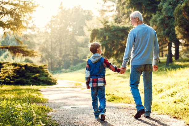 Grandfather and grandson together outdoors family concept stock photo