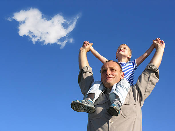 grandfather and grandson with cloud stock photo