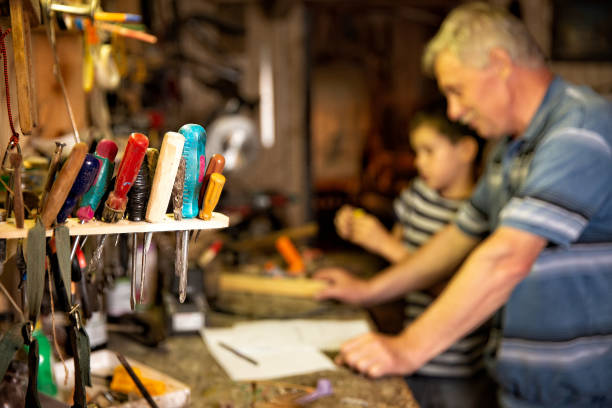 grandfather and grandson work with tools stock photo