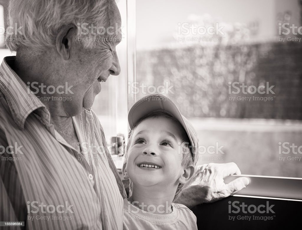 Grandfather And Three-Years-Old Grandson Laughing Together royalty-free stock photo