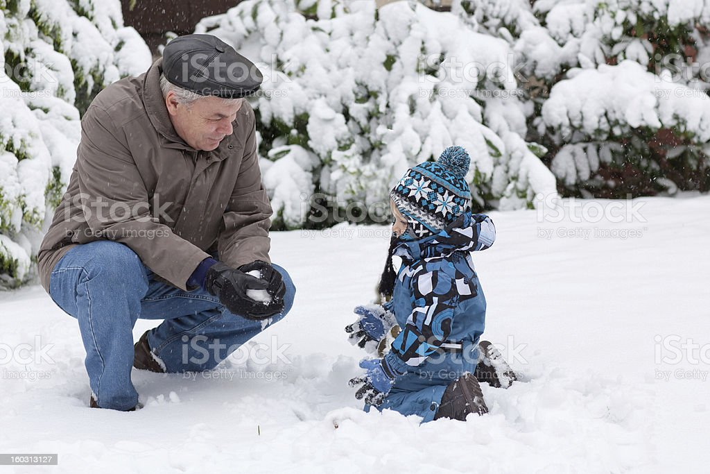 Grandfather and toddler boy  on winter day stock photo