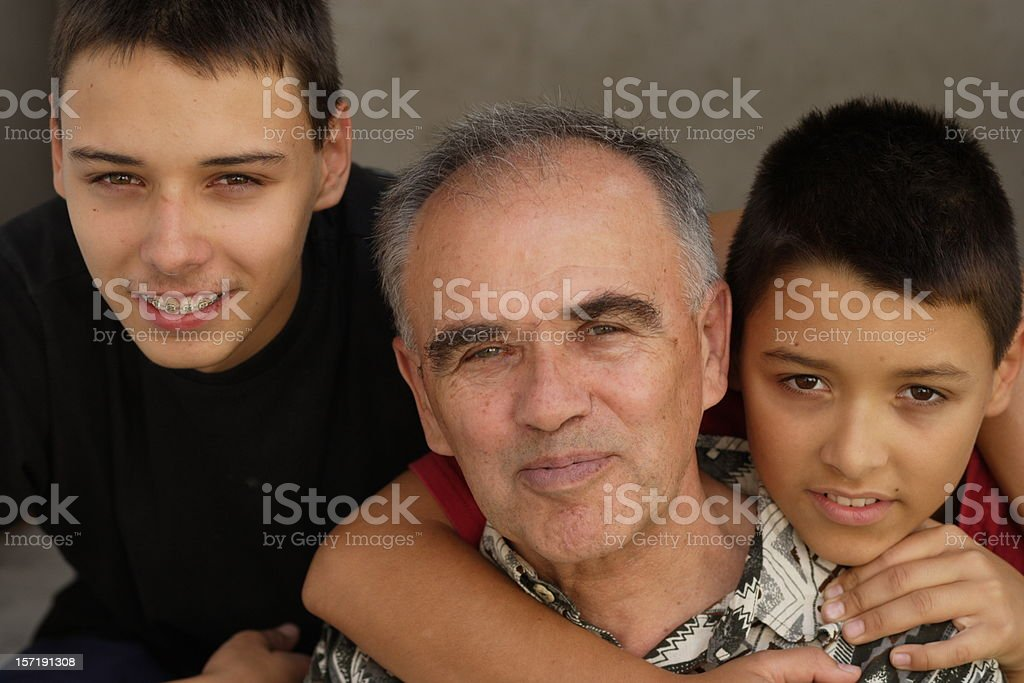 Grandfather and two boys royalty-free stock photo