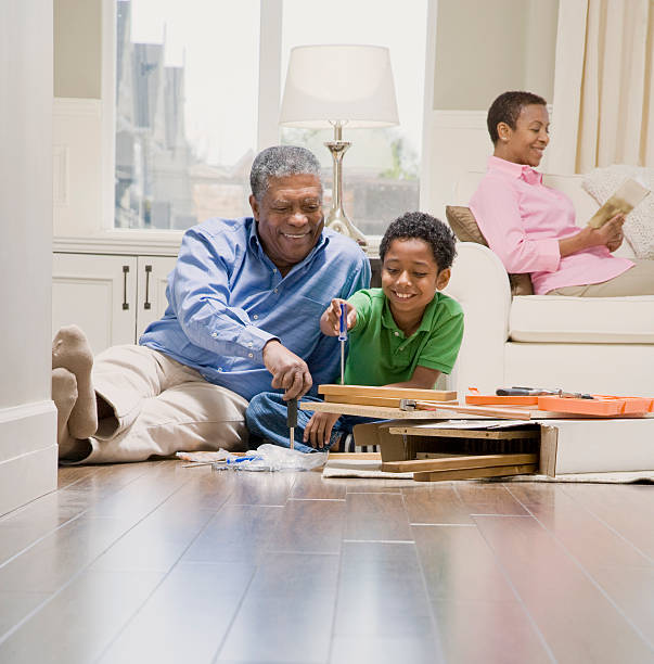 Grandfather Assembling Furniture With Grandson stock photo