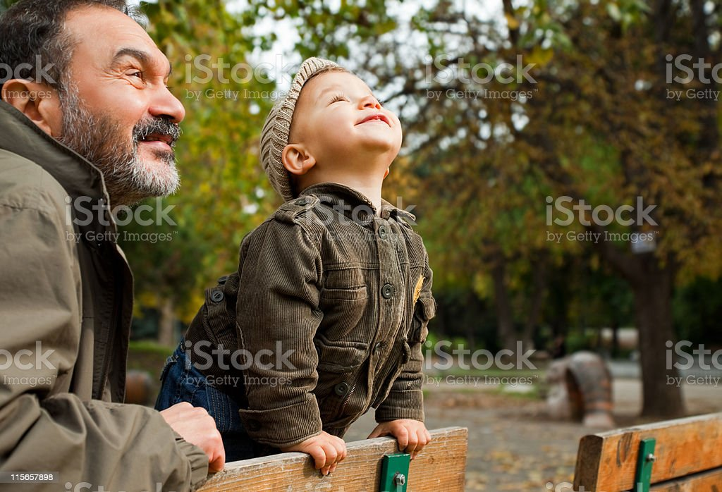 Grandfather child autumn stock photo