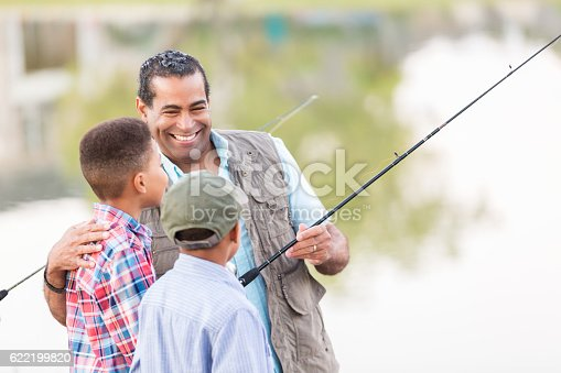 istock Grandfather enjoys fishing with grandsons 622199820