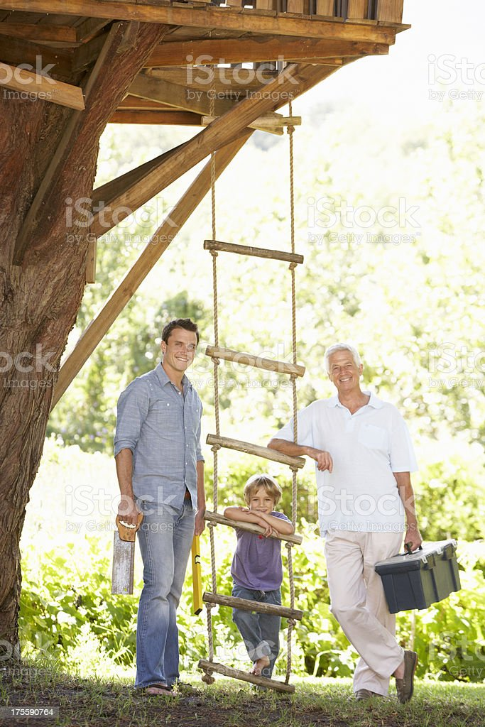 Grandfather, Father And Son Building Tree House Together royalty-free stock photo