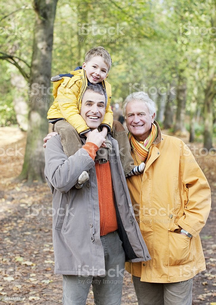 Grandfather, father and son walking outdoors royalty-free stock photo