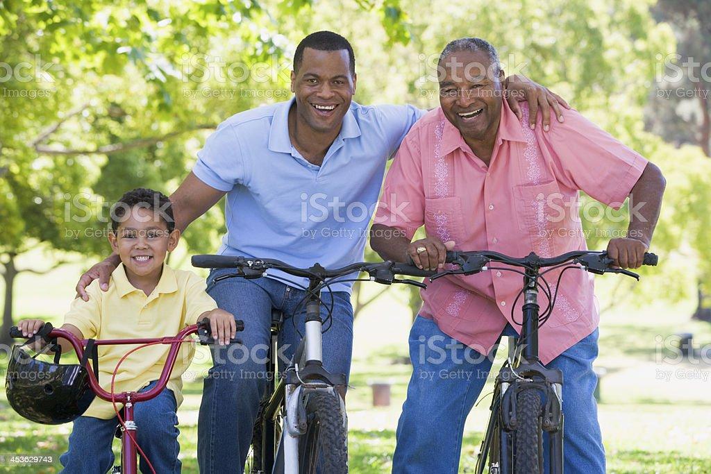 Grandfather grandson and son bike riding stock photo