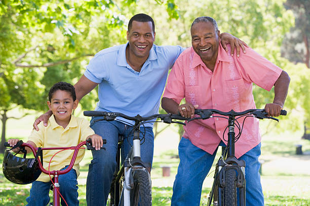 Grandfather grandson and son bike riding stock photo