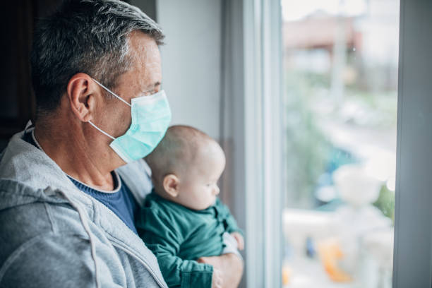 grandfather into quarantine with his grandson - fragilidade imagens e fotografias de stock