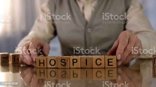 Grandfather making word hospice of wooden cubes on table elder care picture id1164674200?b=1&k=6&m=1164674200&s=612x612&h=roegaahlsk4j3bdhizkkcbvtqsnbablo 50j0jw8pzm=