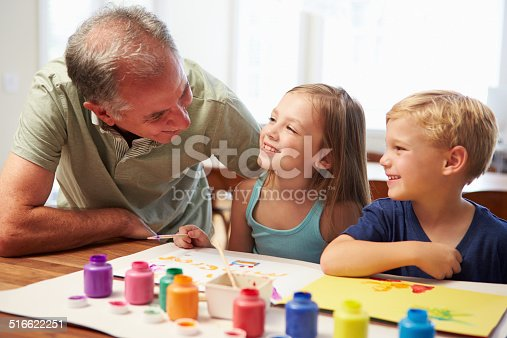 istock Grandfather Painting Picture With Grandchildren At Home 516622251