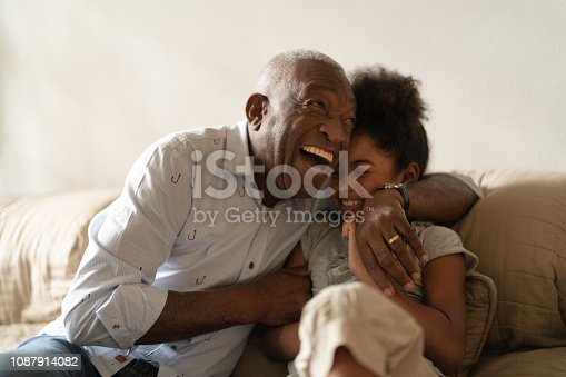 istock Grandfather Playing with Her Granddaughter at Home 1087914082