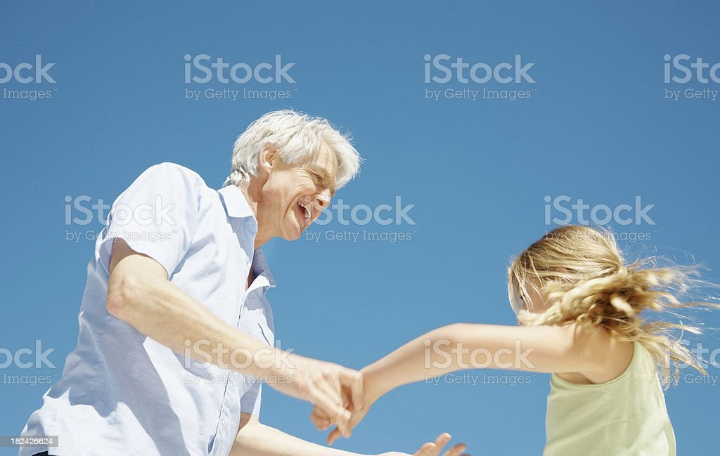 Grandfather playing with his granddaughter royalty-free stock photo