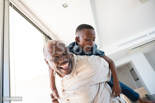 A grandfather spends some quality time with his grandson at the family gathering