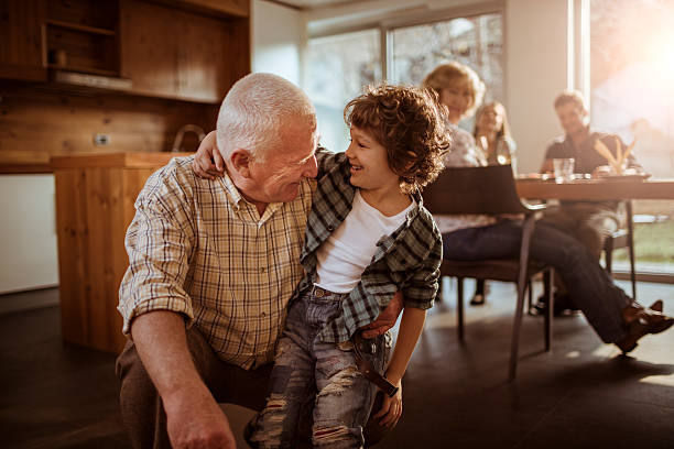 Grandfather playing with his grandson Close up of a grandfather playing with his grandson grandson stock pictures, royalty-free photos & images