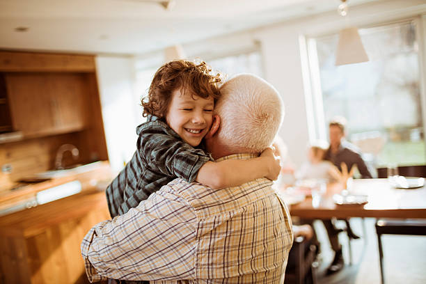 Grandfather playing with his grandson stock photo