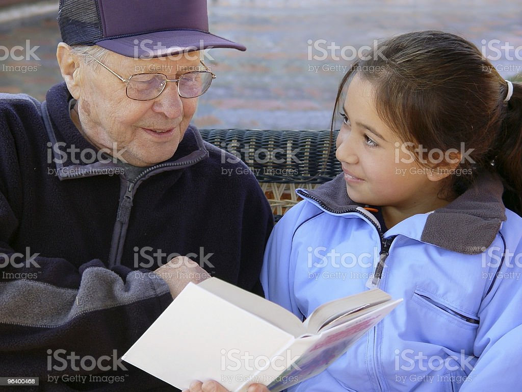 Grandfather reading a book royalty-free stock photo