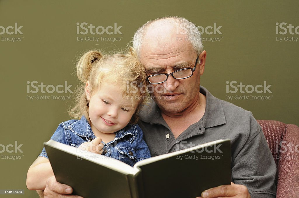 Grandfather reading royalty-free stock photo