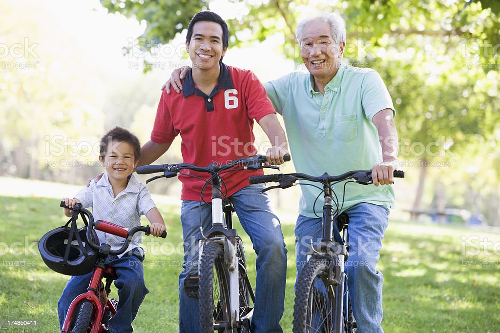 Grandfather son and grandson bike riding stock photo