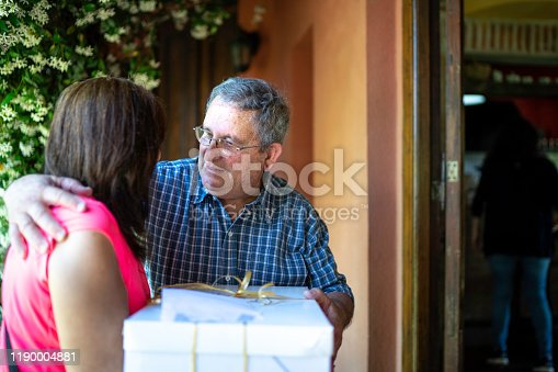 1196170672istockphoto Grandfather welcoming neighbor at rural home 1190004881
