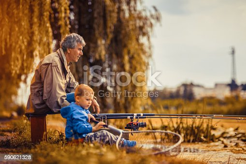 483319252istockphoto Grandfather with a  grandson on fishing. 590621328