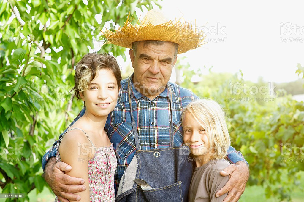 Grandfather with grandchildren in the vineyard royalty-free stock photo