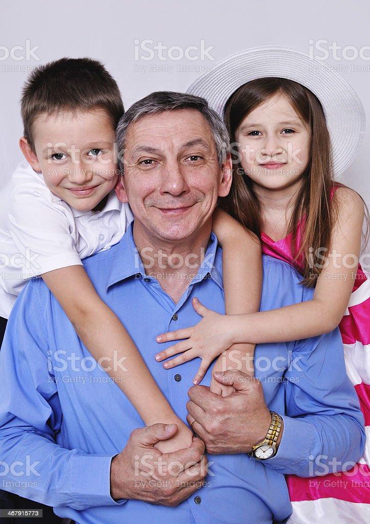 Grandfather with grandchildren stock photo