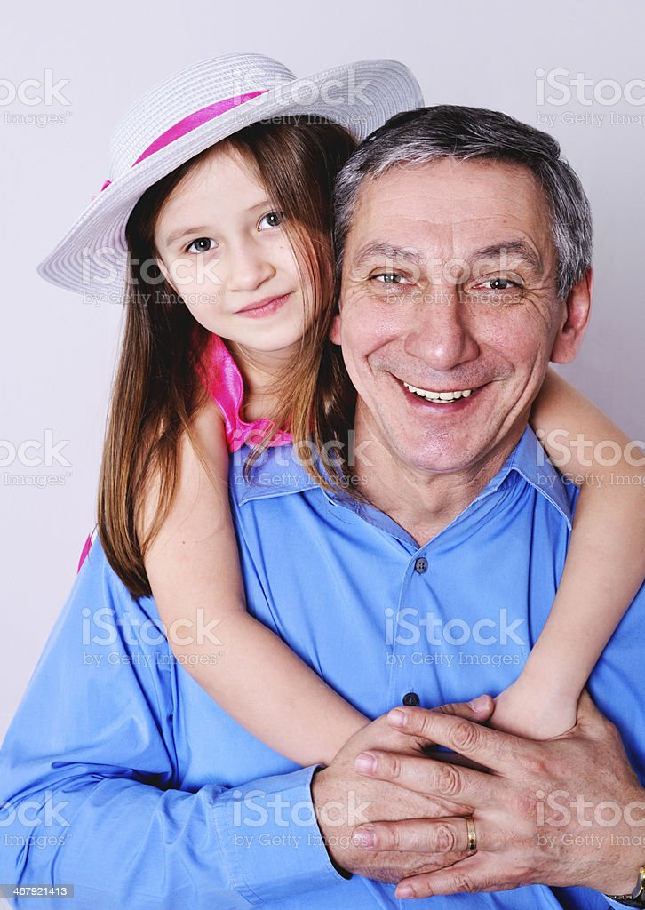 Grandfather with granddaughter stock photo