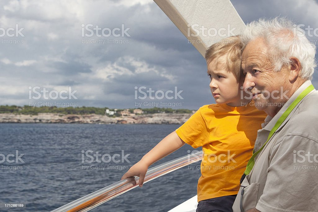 Grandfather With Grandson On A Boat Trip royalty-free stock photo