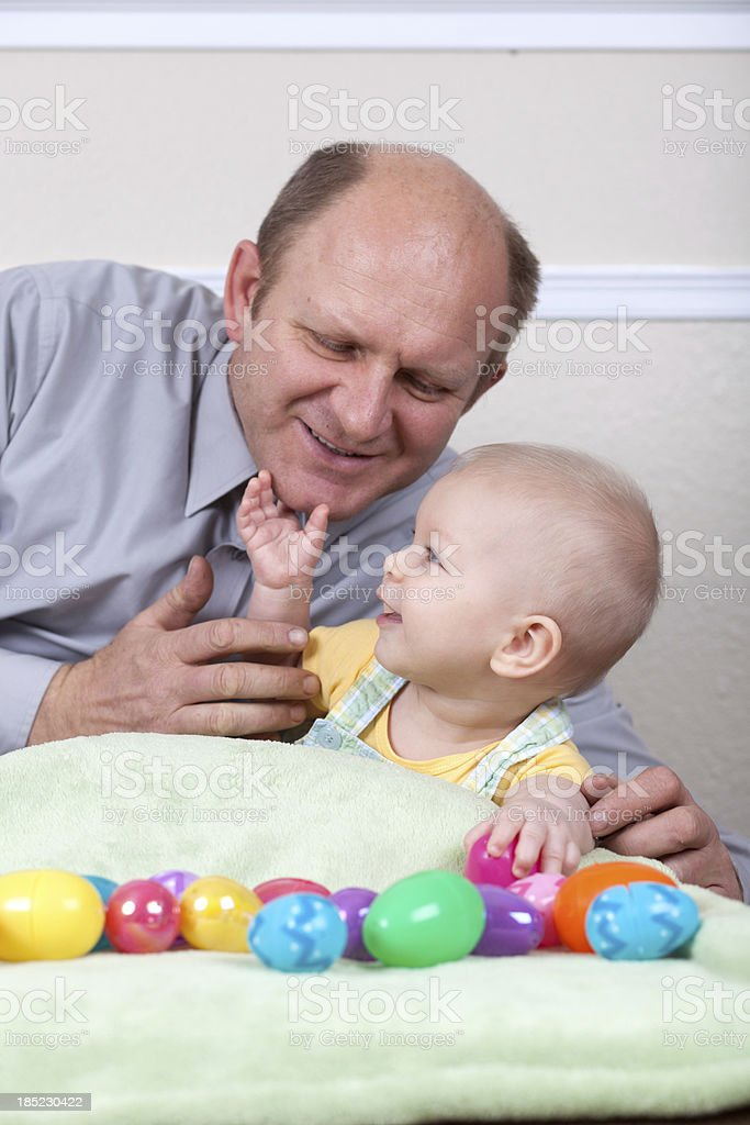 Grandfather with grandson playing happy royalty-free stock photo