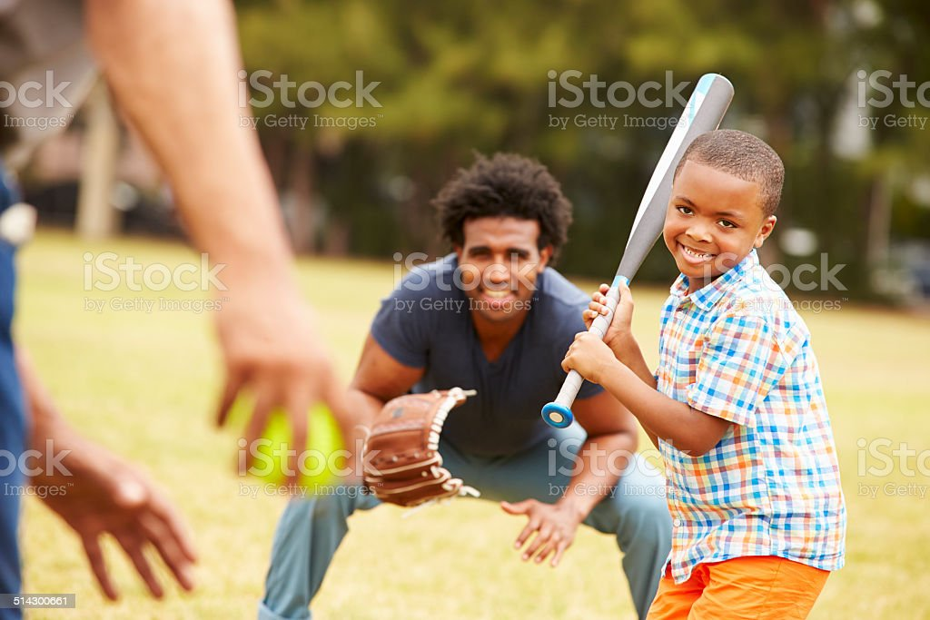 Grandfather With Son And Grandson Playing Baseball stock photo