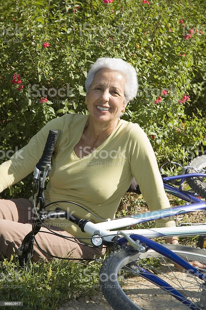 Grandma and bicycle royalty-free stock photo
