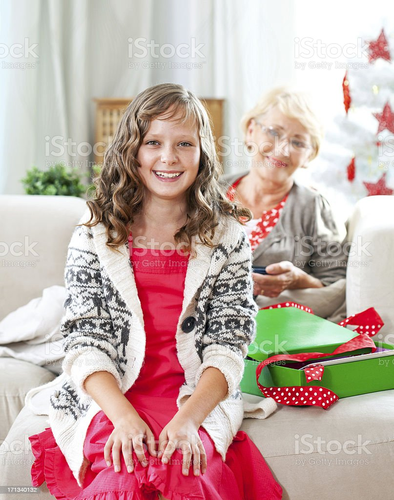 Grandma and grandchild celebrating Christmas royalty-free stock photo