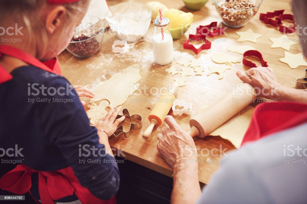 Grandma and granddaughter preparing cookies stock photo