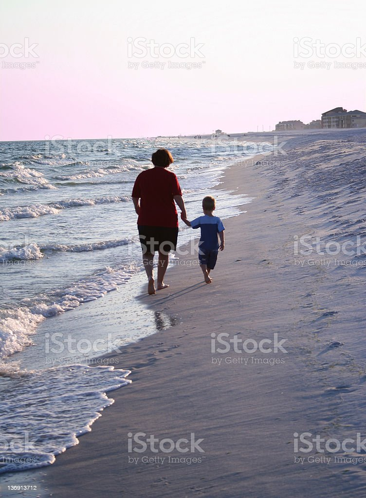 Grandma and Grandson walking on beach royalty-free stock photo