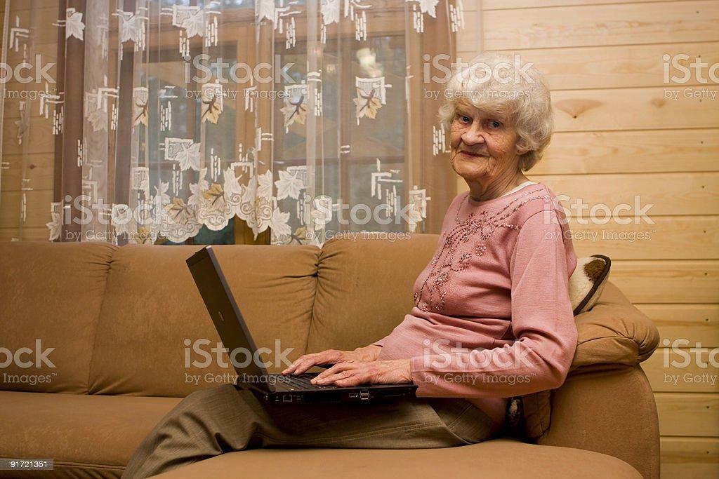 Grandma and laptop royalty-free stock photo