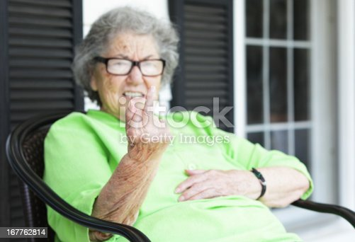 istock Grandma Flipping the Bird From Her Front Porch 167762814