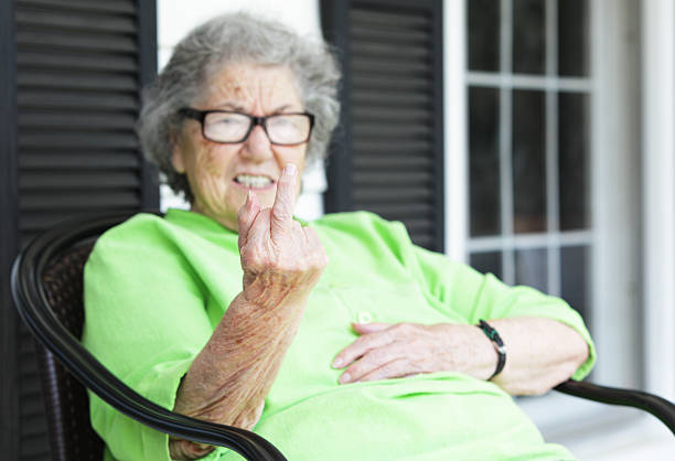 grandma flipping the bird from her front porch - funny fat lady stock photos and pictures