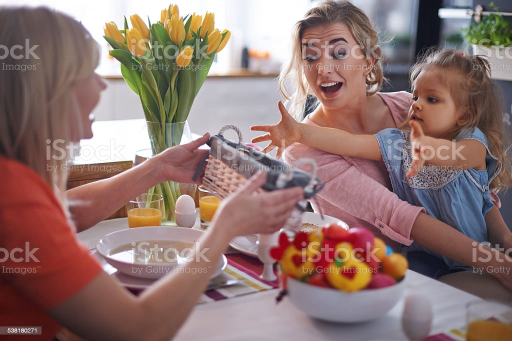 Grandma, give me one piece of bread stock photo