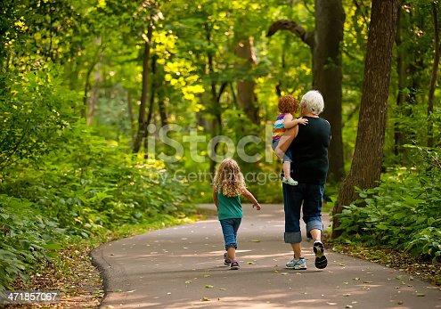 istock Grandma & Graunddaughters Walking on Park Trail 471857067