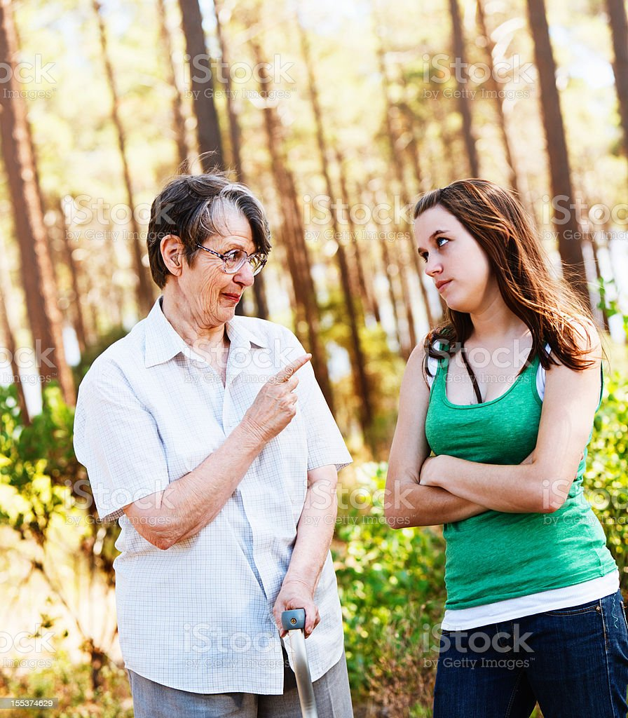 Grandma knows best: old lady wags finger at granddaughter royalty-free stock photo