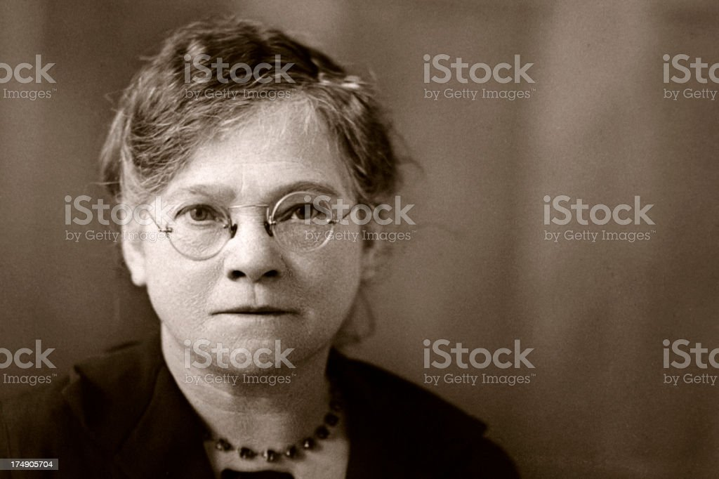 Grandma Vintage photograph of an old lady wearing round spectacles. 70-79 Years Stock Photo