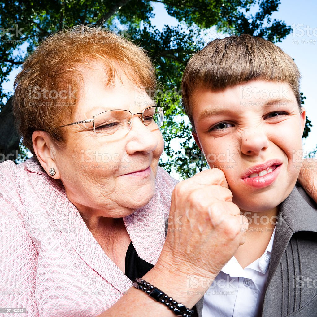 Grandma Pinching her Grandson royalty-free stock photo