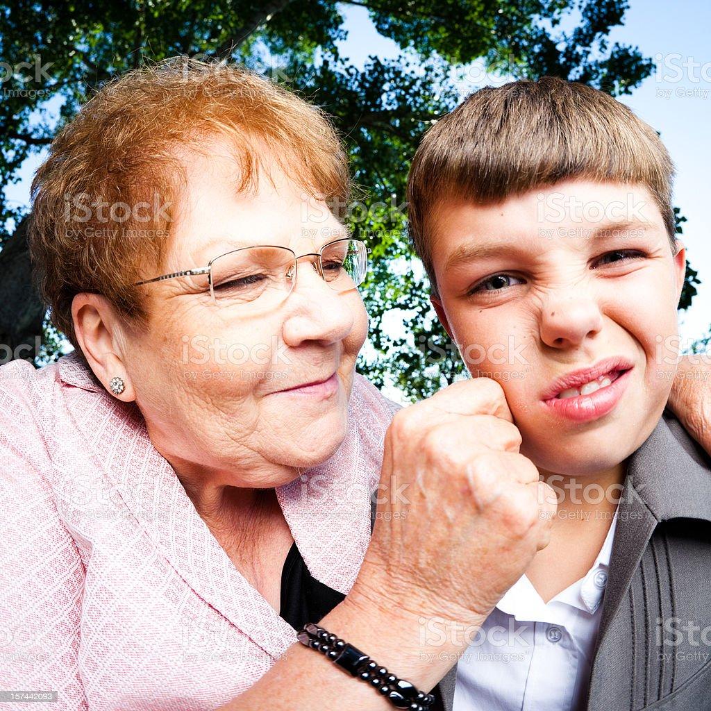 Grandma Pinching her Grandson stock photo